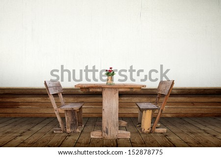 Picture frames and old wood chair in room - stock photo