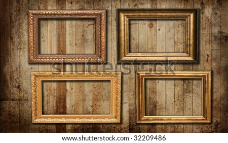 Picture frames hanging on a cedar panel wall. - stock photo