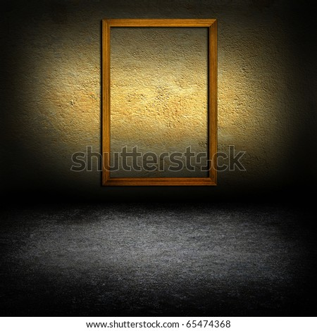 picture frames on concrete wall - stock photo