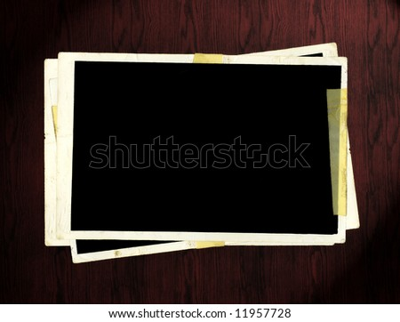 Picture Frames On Wooden Table - stock photo