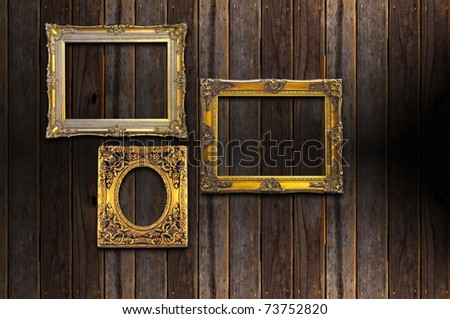 picture gold frame on a wood background - stock photo
