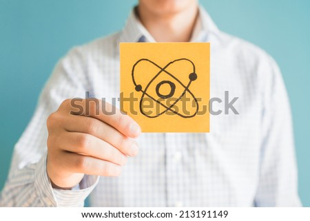 Picture icon atom in the hand - stock photo