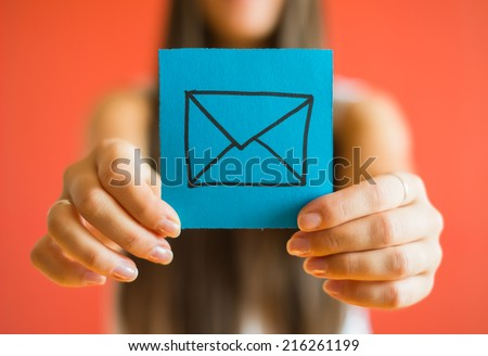 Picture icon envelope in his hand - stock photo