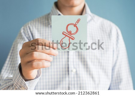 Picture icon nipple in his hand - stock photo