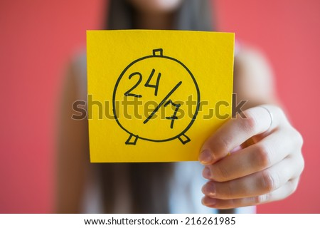 Picture icon round the clock in hand - stock photo