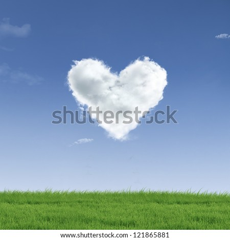 Picture of a a heart cloud on blue sky  and green field
