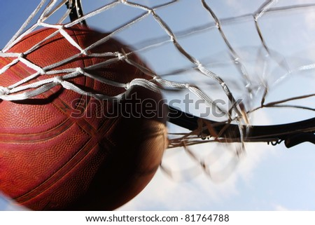Picture of a basketball field goal with the sky in background. - stock photo