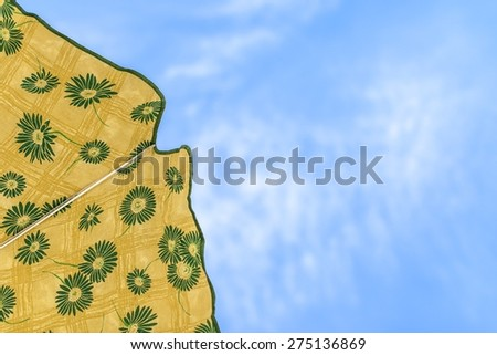 Picture of a beach umbrella with sky background - stock photo