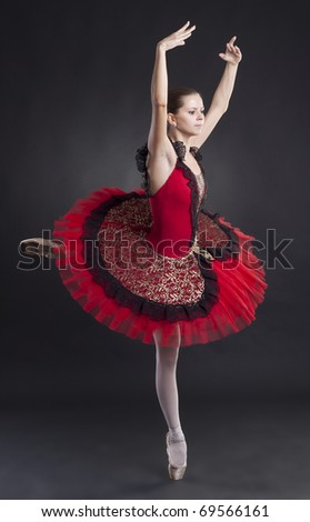 picture of a beautiful ballerina posing in a red tutu - stock photo