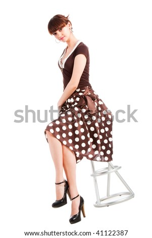 Picture of a beautiful charming young girl on chair. Isolated on white. - stock photo