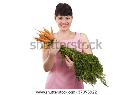 Picture of a beautiful smiling girl holding bunch of carrots against background. Isolated over white background.