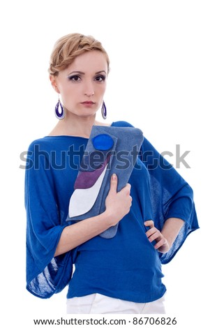 picture of a beautiful young woman holding a fashion purse , and wearing nice earings, over white - stock photo