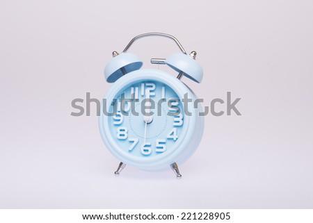 Picture of a blue retro alarm clock - stock photo