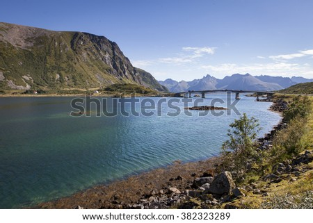 Picture of a bridge crossing a deep fjord at Lofoten islands - stock photo