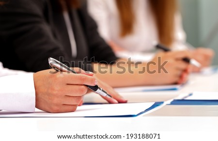Picture of a business woman hand signing the contract - stock photo
