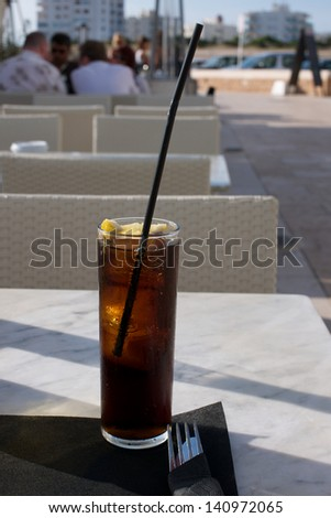 Picture of a cold cola on a table on an outside cafe - stock photo