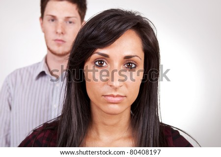 Picture of a couple after a fight. Woman in front - stock photo