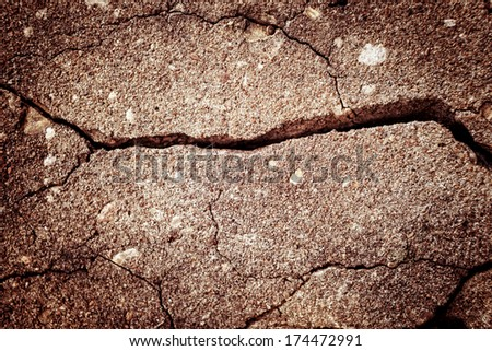 Picture of a cracked asphalt texture - stock photo