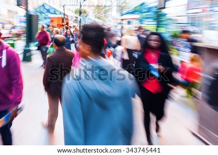 picture of a crowd of people on the move in the city with camera made zoom effect
