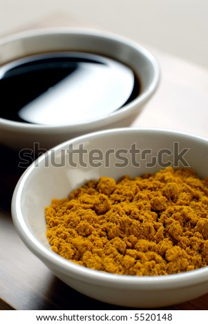 Picture of a curry and soya sauce on a white tureen - stock photo