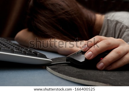 Picture of a cute teenage girl sleeping on her computer - stock photo