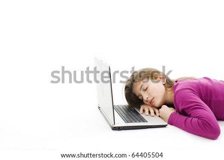 Picture of a cute teenage girl sleeping on her laptop computer, isolated on white background - stock photo