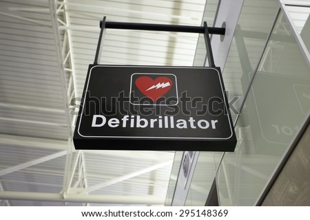 Picture of a defibrillator sign at airport for AED Automated External Defibrillators - stock photo