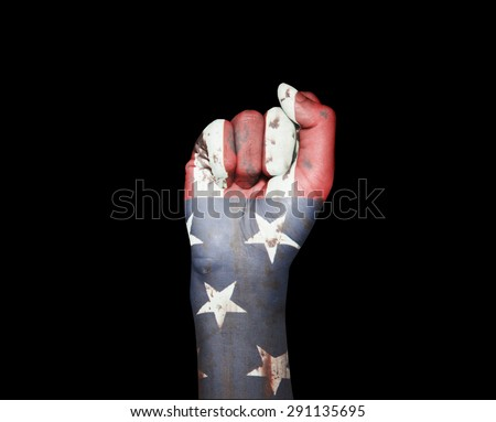 picture of a fist painted in colors of american flag - stock photo