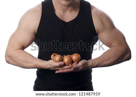 Picture of a fit, muscular body holding vegetables, on a white, isolated background - stock photo