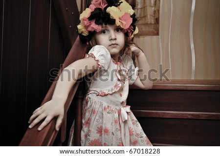 Picture of a funny little girl playing top model
