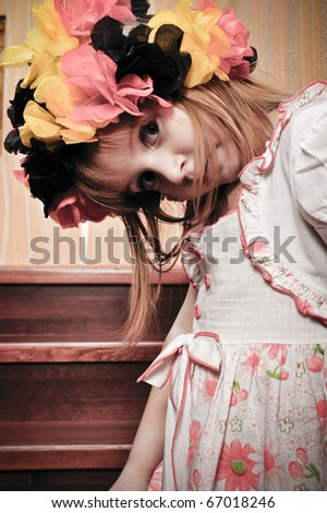 Picture of a funny little girl playing top model - stock photo