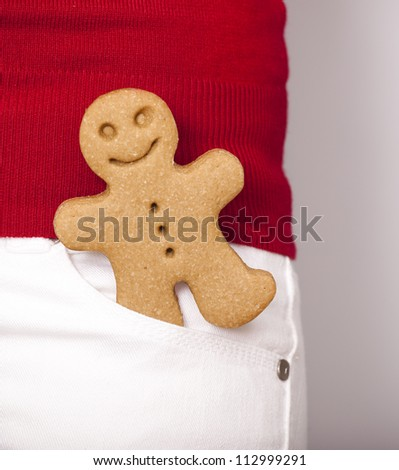Picture of a gingerbread cookie on the pants pocket