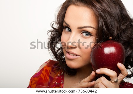 Picture of a happy beautiful woman holding big red apple in hands - stock photo