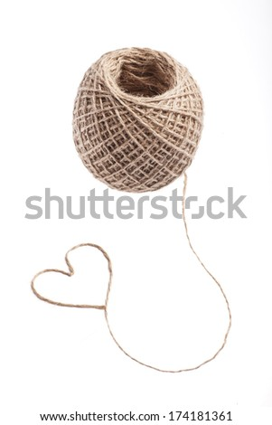 Picture of a heart made of rope, near a rope ball - stock photo