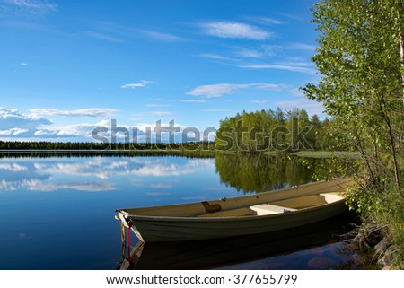 Picture of a lake in Lapland, Finland, taken in June. - stock photo