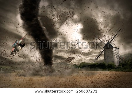 Picture of a large tornado destroying the landscape - stock photo