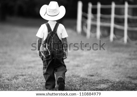 A Boy Walking Away From A Girl Picture of a little boy in a cowboy hat and overalls, walking away ...