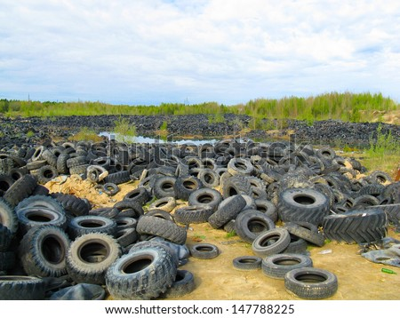 Picture of a lot of old tires outdoors - stock photo