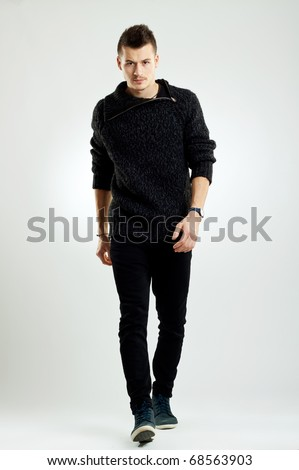 picture of a male fashion model wearing wool sweater, walking - stock photo