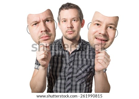 Picture of a man choosing the right face for the day - stock photo