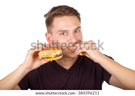 Picture of a man eating a delicious cheeseburger - stock photo