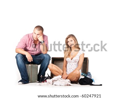 Picture of a man on a suitcase waiting for his girl