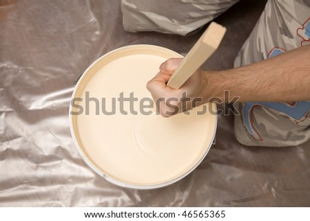 Picture of a man's hand mixing paint
