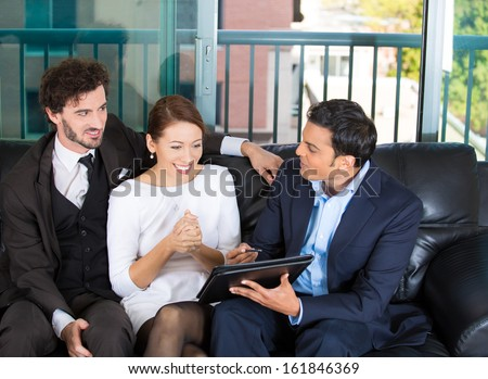 Picture of a manager, financial consultant, banker presenting to a young smiling couple a business investment opportunity plan, isolated on a background of city buildings. Finance smart decisions.  - stock photo