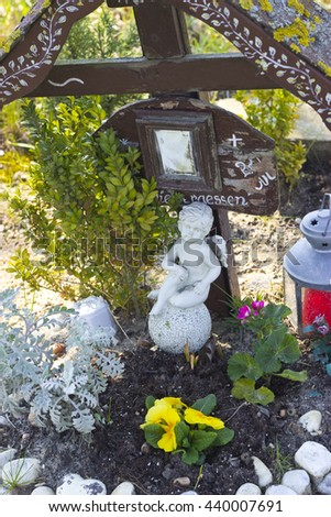 Picture of a memorial cross and angel figurine for accident victim - stock photo
