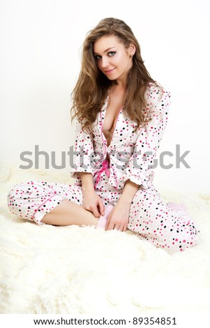 Picture of a morning sweet young girl in pink pajamas. - stock photo