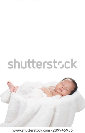 picture of a newborn baby curled up sleeping on a blanket