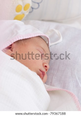 picture of a newborn baby sleeping in baby crib - stock photo