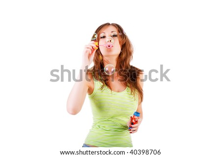 Picture of a pretty young girl blow bubbles on white - stock photo