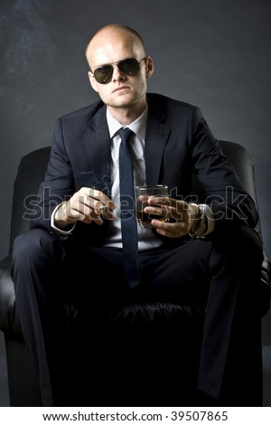 picture of a rich man smoking a cigarette and drinking whiskey